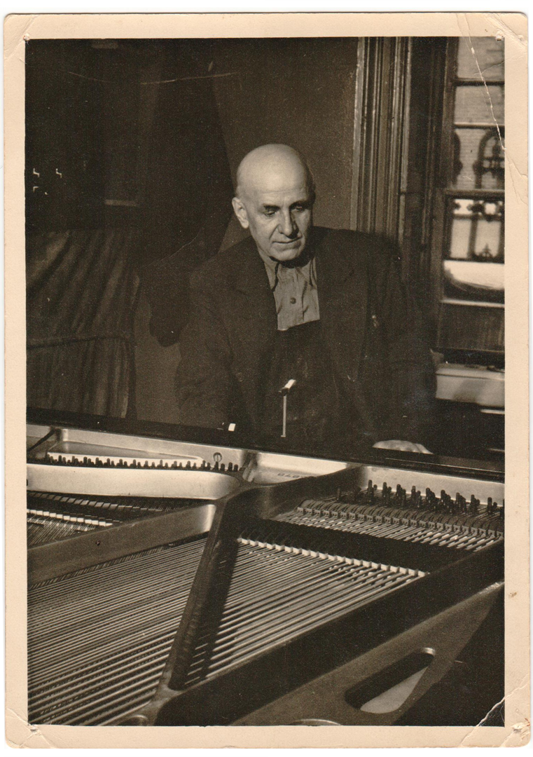 John Fekete working on a grand piano